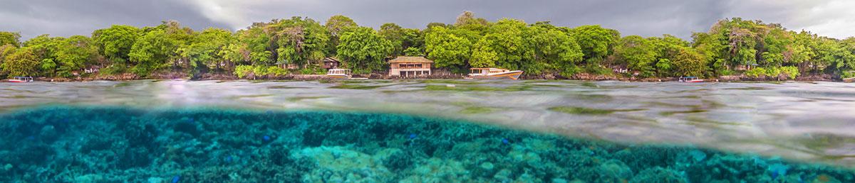 Indonesia, Manado, Bunaken Island, Seabreeze Resort, Restaurant with Boat and Coral Reef