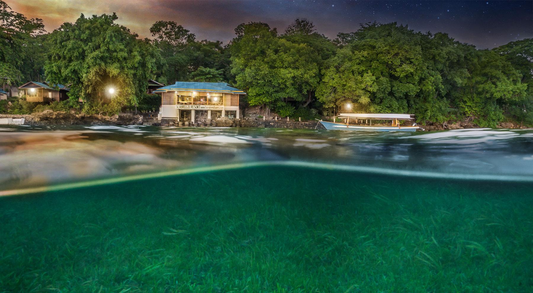 Indonesia, Manado, Bunaken Island, Seabreeze Resort, Restaurant with Boat at Night