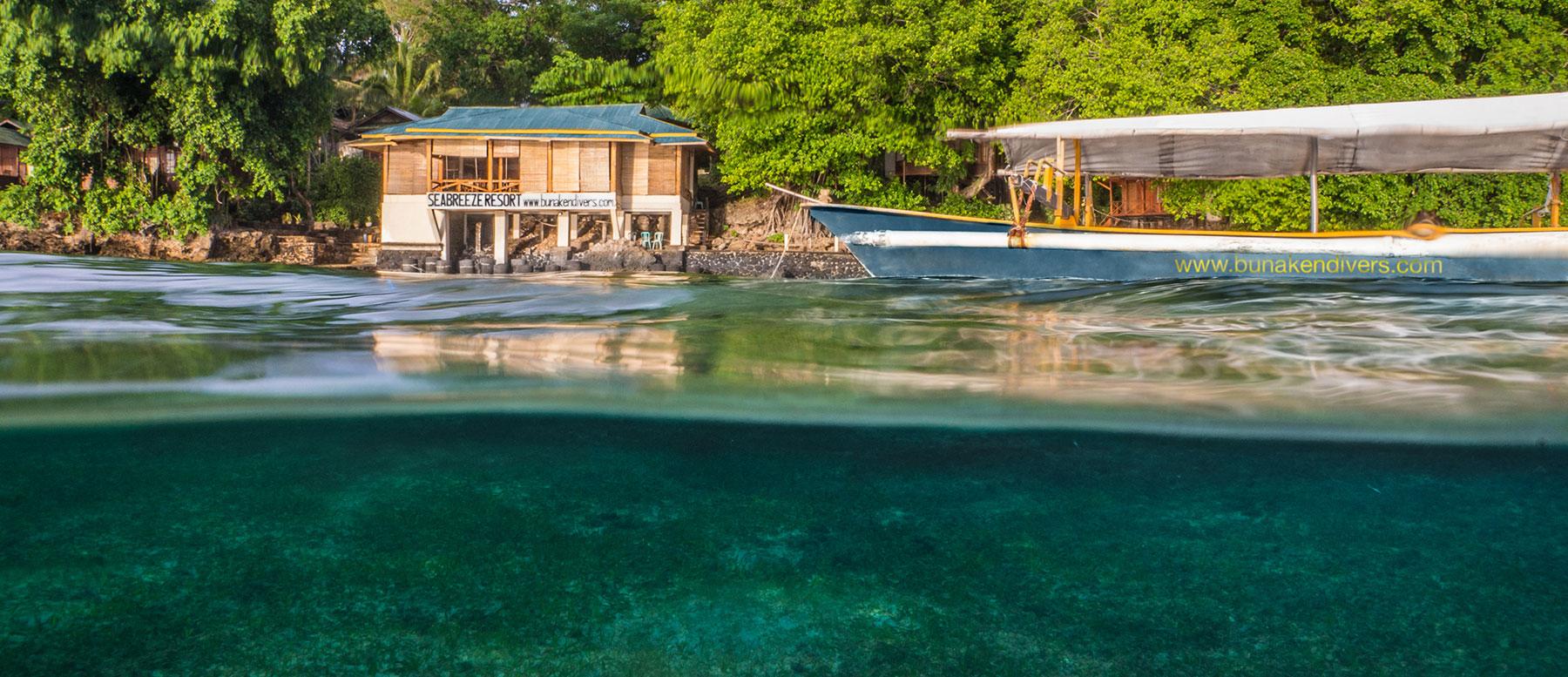 Indonesia, Manado, Bunaken Island, Seabreeze Resort, Restaurant with Boat