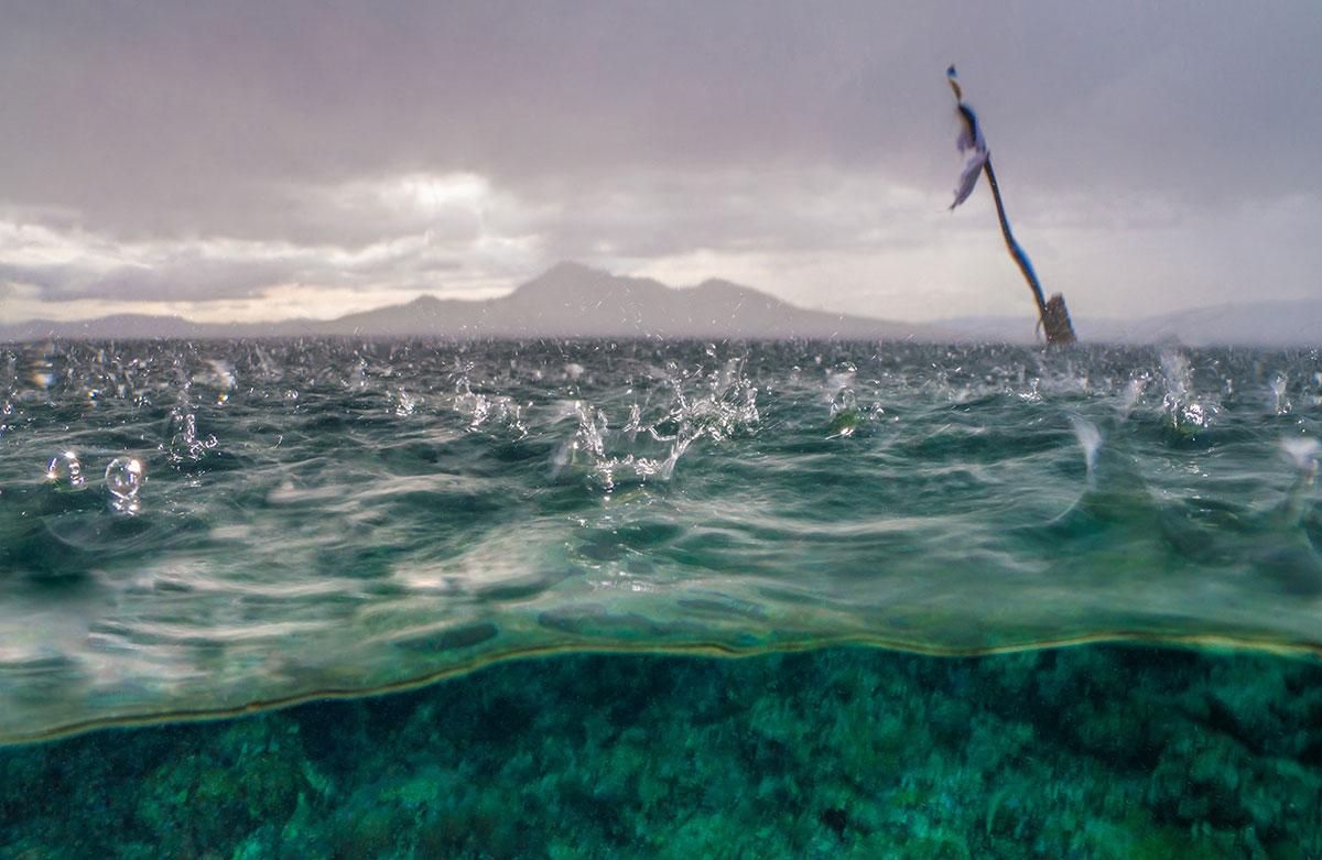 Indonesia, Manado, Bunaken Island, Raindrops on Water
