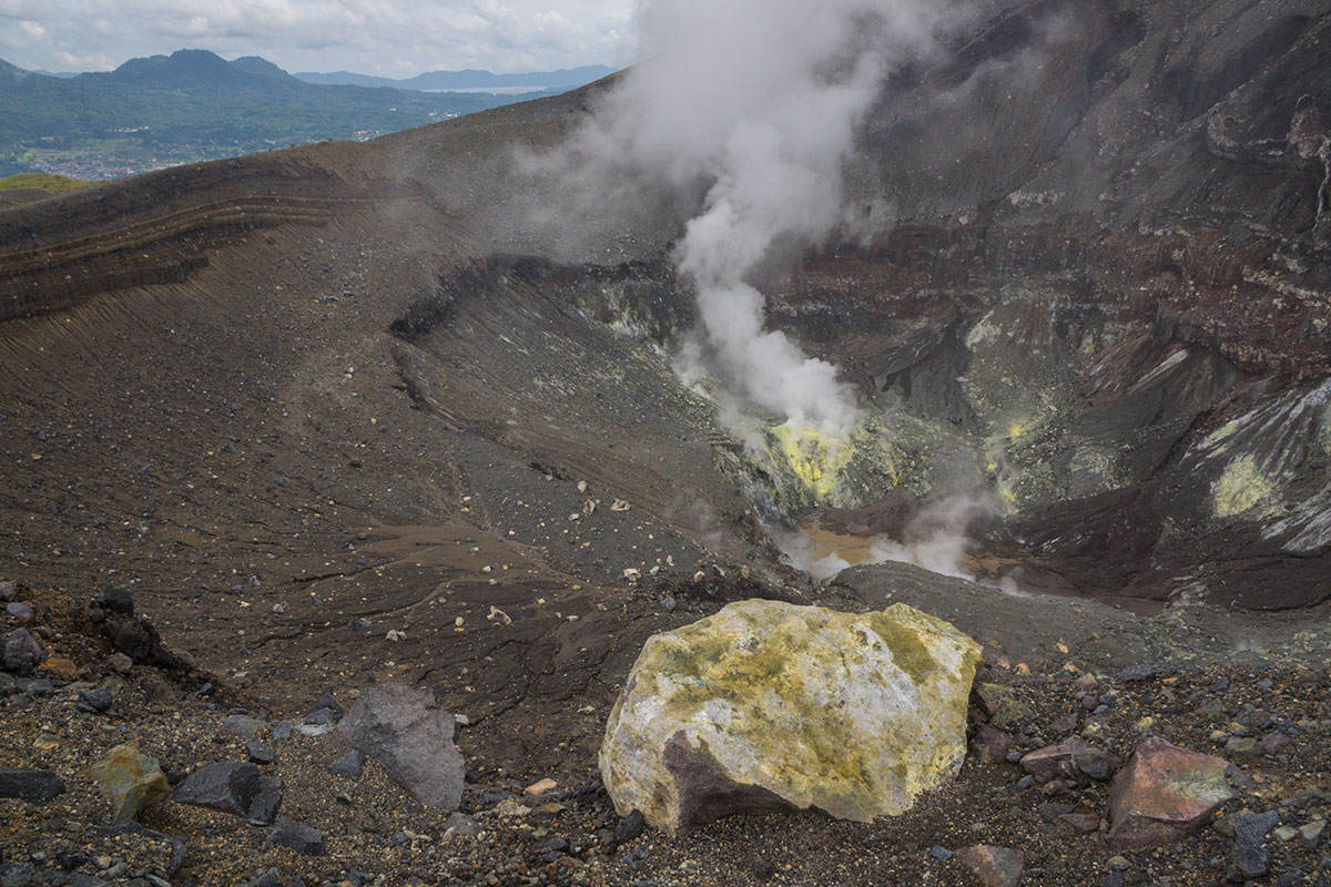 Indonesia, Manado, Lokon Volcano Trekking Tour, view into Crater, sulfur block