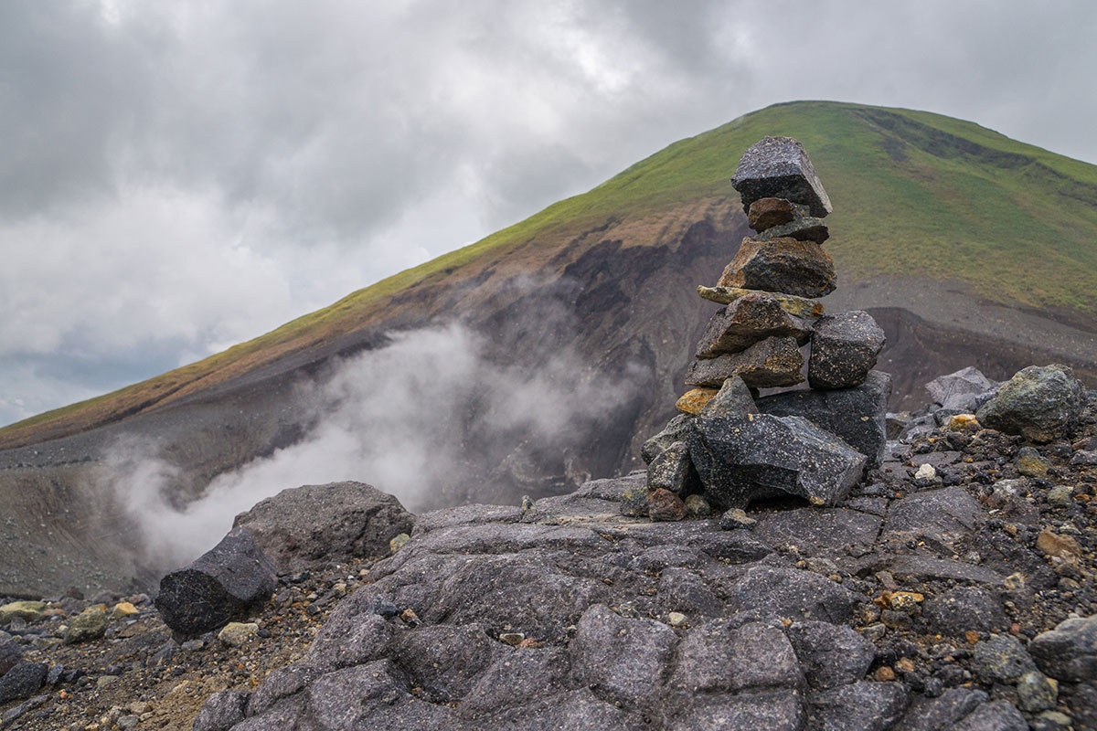 Indonesia, Manado, Lokon Volcano Trekking Tour, Stone man at the edge of the crater
