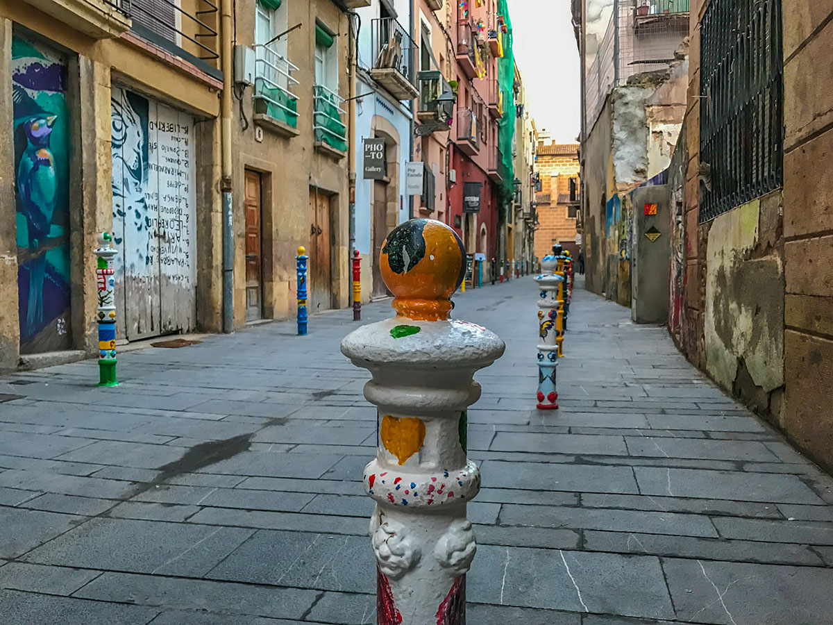 Spain, Catalonia, Tarragona, alley with painted poles